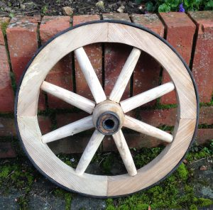 A wooden Wheelbarrow Wheel